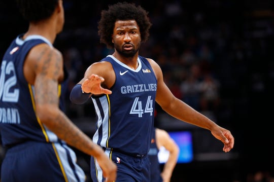Memphis Grizzlies forward Solomon Hill high-fives teammate Ja Morant as they take on the San Antonio Spurs at the FedExForum on Monday, Dec. 23, 2019.