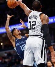 Memphis Grizzlies guard Ja Morant is blocked by San Antonio Spurs center LaMarcus Aldridge during their game at the FedExForum on Monday, Dec. 23, 2019.