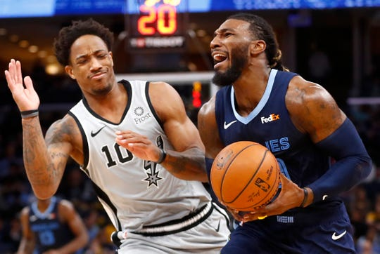 Memphis Grizzlies forward Jae Crowder is fouled by San Antonio Spurs forward DeMar DeRozan during their game at the FedExForum on Monday, Dec. 23, 2019.