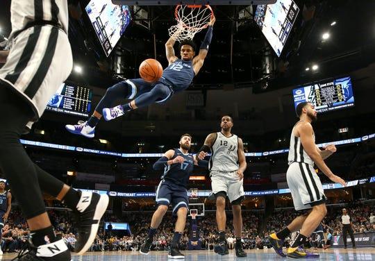 Grizzlies guard Ja Morant dunks against the Spurs during their game Dec. 23 at FedExForum.