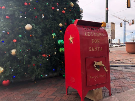 "The ""Letters for Santa"" mailbox sits in front of the large Christmas tree on the corner of South Main Street and Peabody Place in Downtown Memphis, open for both wishlists and thank you letters."