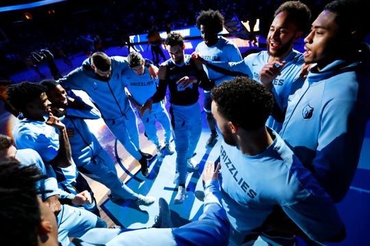Memphis Grizzlies players huddle up before their game against the San Antonio Spurs at the FedExForum on Monday, Dec. 23, 2019.