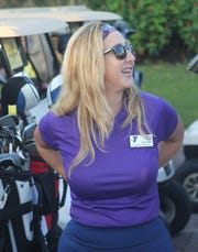 Ashley Lupo, who is president of the Y, socializes before the start of the tournament. She played in the mixed division.