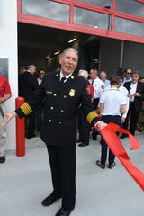 Fire-Rescue Chief Michael Murphy celebrates after the official ribbon cutting of fire station 51 on March 15, 2019.