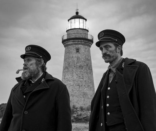 "Willem Dafoe, left, and Robert Pattinson appear in a scene from ""The Lighthouse."""
