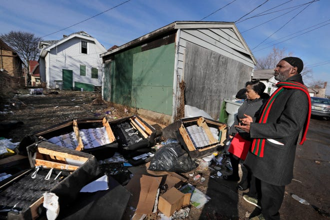 Denisha Tate-McAlister and Jeramie Rice Bey tour areas of the Amani neighborhood near North 24th and West Locust Street, where they have observed illegal dumping at vacant lots and abandoned houses. They are trying to clean up the area as part of a plan to be the first home in a beautification effort around the block.