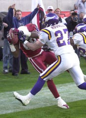 Arizona Cardinals Nathan Poole makes the game-winning catch with no time on the clock as Minnesota Vikings Brian Russell (27) defends Sunday, Dec. 28, 2003 at Sun Devil Stadium in Tempe, Ariz. The Cardinals won 18-17. (AP Photo/Paul Connors)