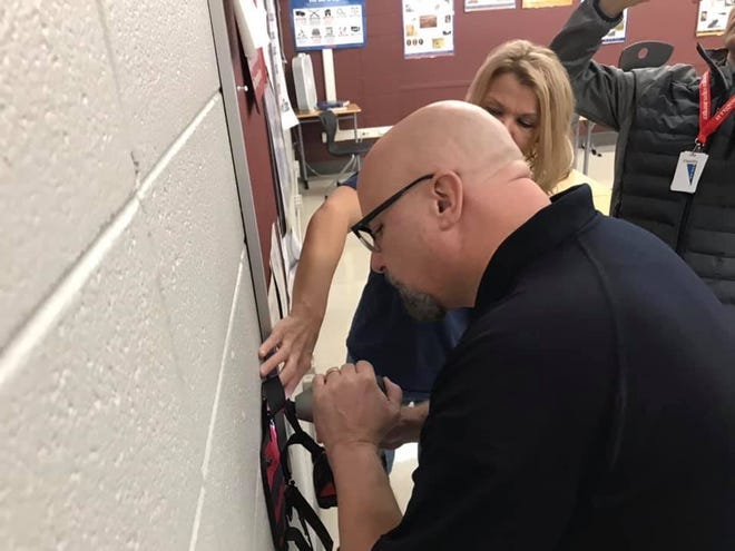 St. Francis Mayor Ken Tutaj and Terre Kent, an FBI Milwaukee Citizens Academy Alumni Association Rep, installing a mass casualty first aid kit in a local classroom. The St. Francis Fire Department and FBIMCAAA are working to get a kit into every classroom in the city.