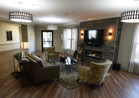 This sitting area at Hiram Shaddox Health & Rehab includes a large TV and fireplace. The nursing home hopes to evoke a feeling of home for residents instead of the stereotypical images of a long-term living facility.