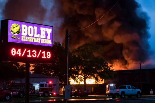 Smoke billows from Boley Elementary in West Monroe, La. after the building caught fire on April 13. Firefighters were unable to contain the fire before it spread to other parts of the building when they initially responded about 5 p.m. and as of 8 p.m. the fire was still not under control. The cause of the fire is yet to be determined.