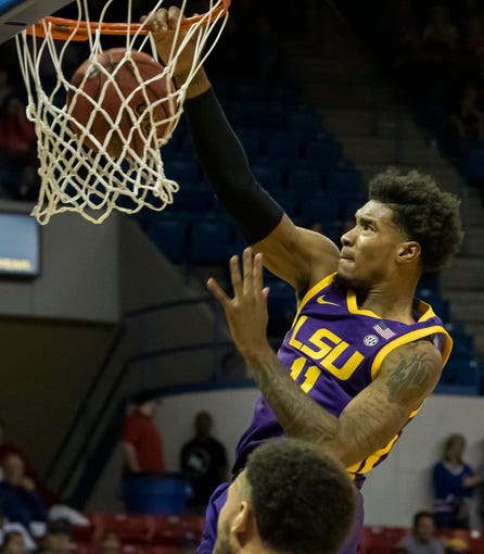 Louisiana State University's Charles Manning Jr. (11) dunks during the exhibition game against Louisiana Tech at the Thomas Assembly Center in Ruston, La. on Nov. 2. Proceeds from the game would go towards relief efforts from the April 25 tornado in Ruston.