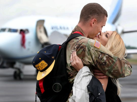 Samantha Whittaker kisses her fiancé Sgt. Wendal Asberry, with the 278th ACR, after he returned to the Volunteer Training Site in Smyrna, following a 9-month overseas deployment on Thursday, May 9, 2019. This photo won third place in the Tennessee Associated Press Broadcasters and Media Editors' annual contest.