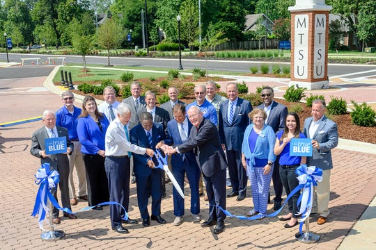 MTSU and the city of Murfreesboro hosted a ribbon-cutting Friday, Aug. 2, to celebrate the completion of an $18.2 million renovation project to Middle Tennessee Boulevard. Cutting the ribbon, from left holding scissors, are former Congressman Bart Gordon, MTSU President Sidney A. McPhee, Murfreesboro Mayor Shane McFarland and U.S. Sen. Lamar Alexander. Pictured with them are a host of state, local and university representatives.