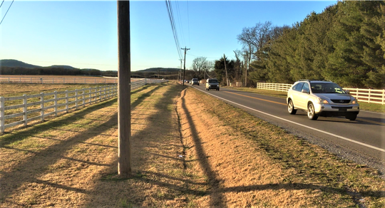 This two-lane stretch of Franklin Road west of Veterans Parkway shows where a 1,900-home subdivision is planned on the left, and a future Rutherford County middle school and high school could be built on 154 acres on the right past the white fence. Local officials want the state to widen this road to five lanes.