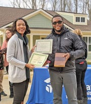 Aubrey Green is the proud new owner of a home dedicated by Habitat for Humanity on Sat., Dec. 14; and looks forward to having a safe, stable home in Fairview to raise her daughter.
