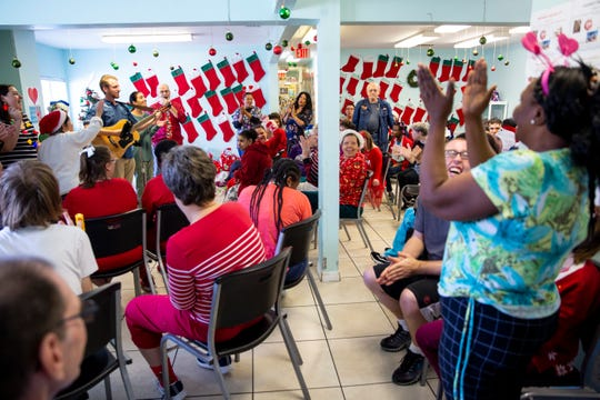 Worship leaders from Golden Gate Assembly of God and Faith Life Worship Center sing Christmas songs with the group at Sunrise Community of Southwest Florida in Naples on Tuesday, Dec. 24, 2019.