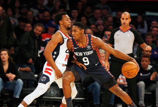New York Knicks forward RJ Barrett (9) dribbles the ball against Washington Wizards guard Ish Smith (14) during the first half at Madison Square Garden.