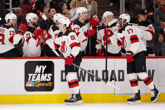 New Jersey Devils center Jack Hughes (86) celebrates with teammates after scoring against the Chicago Blackhawks during the first period at United Center.