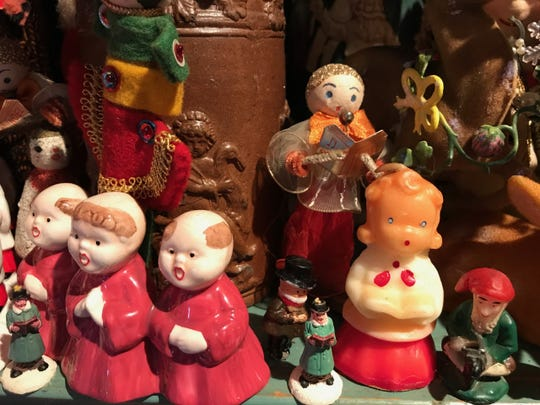 A section of singers includes a 1950 choir candle, garnered from estate sales.
