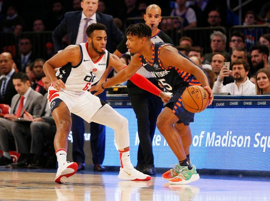 New York Knicks guard Dennis Smith Jr. (5) dribbles the ball against Washington Wizards guard Troy Brown Jr. (6) during the first half at Madison Square Garden.