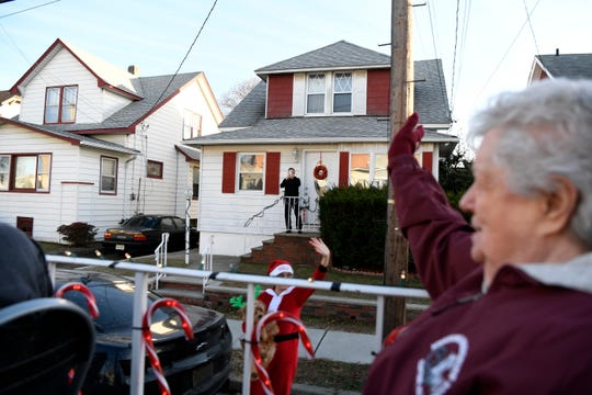 Clifton residents wave to Santa as he and Mrs. Claus travel through the town for the 50th annual Christmas Eve sleigh ride on Tuesday, Dec. 24, 2019.