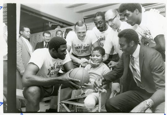 Sammie Davis, badly injured in a Passaic train accident, had his biggest night  July 16, 1969 as pro and college basketball stars played a benefit for him. Surrounding the youngster were Willis Reed, Bob Verga, Emmett Bryant, chairman Dick Vitale, Shaler Halimon, and Johnny Green, the winning coach.