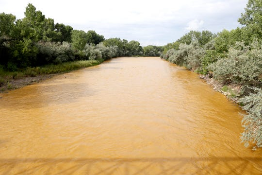 The Gold King Mine spill turned the Animas River a mustard color, as seen on Aug. 8, 2015 in Berg Park.