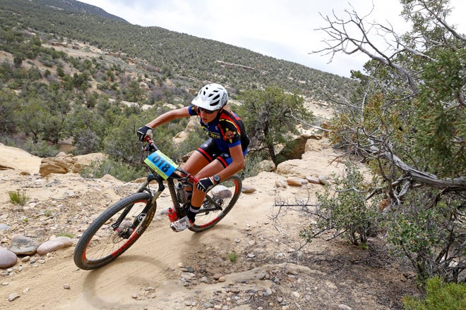 A rider makes a tight turn near the edge of a cliff, May 3, 2015, during the 15th annual Alien Run Mountain Bike Competition.