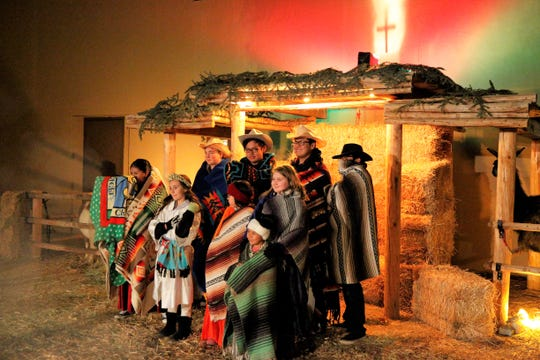 Children dressed in traditional clothing for Navajo Ministries' annual drive-thru Nativity scene at Navajo Ministries on Dec. 23, 2019.