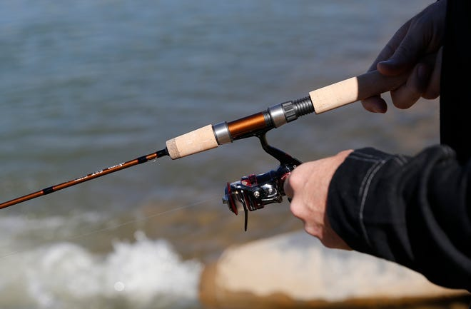Josh Ashton reels in his line, Tuesday, Oct. 13, 2015, at Tiger Park Reservoir in Aztec.