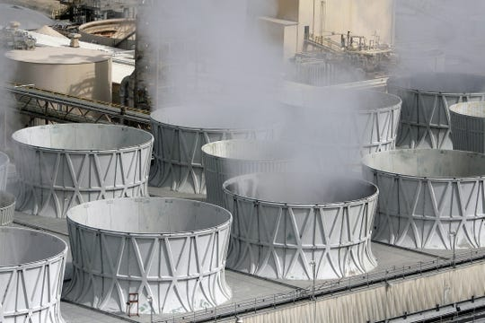 Cooling towers are scene, Tuesday, Oct. 7, 2014,  during a tour of the San Juan Generating Station in Waterflow.