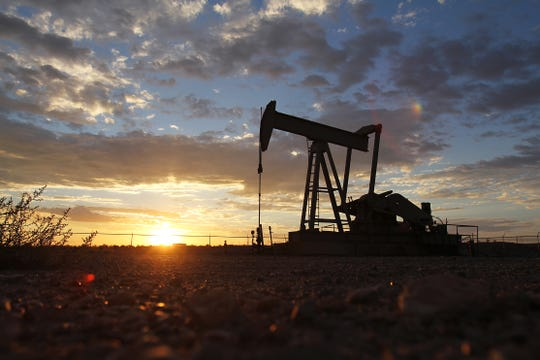 A pump jack is seen in September 2012 off Road 6480 during sunset.