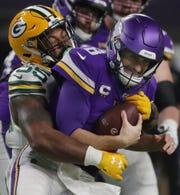 Green Bay Packers outside linebacker Za'Darius Smith (55) sacks Minnesota Vikings quarterback Kirk Cousins (8) during the second quarter of their game Monday, December 23, 2019 at US Bank Stadium in Minneapolis, Minn.