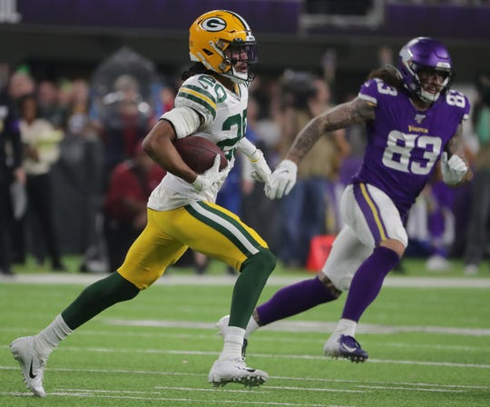 Green Bay Packers cornerback Kevin King (20) returns an interception during the third quarter of their game Monday, December 23, 2019 at US Bank Stadium in Minneapolis, Minn. The Green Bay Packers beat the Minnesota Vikings 23-10.