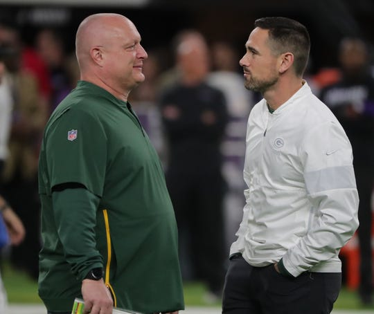 Green Bay Packers head coach Matt LaFleur, right, speaks with special team coordinator Shawn Mennenga before their game against the Minnesota Vikings Monday, December 23, 2019 at US Bank Stadium in Minneapolis, Minn.