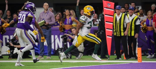 Green Bay Packers running back Aaron Jones (33) scores a touchdown on a12-yard run during the third quarter of their game Monday, December 23, 2019 at US Bank Stadium in Minneapolis, Minn. The Green Bay Packers beat the Minnesota Vikings 23-10.