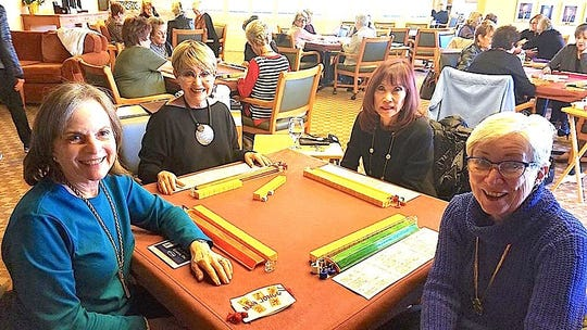 Setsu Hechtmen, Naomi Koosed, Mary Leving and Celia Norian are ready for a game of mahjong.