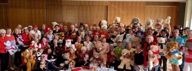 MHWGA members proudly show off their collected teddies.