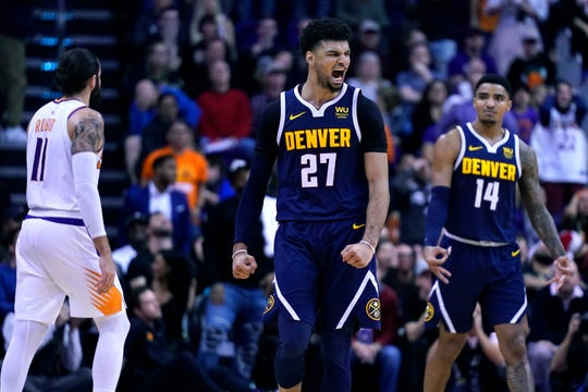 Denver Nuggets guard Jamal Murray (27) reacts after making the game winning basket against the Phoenix Suns in the second half during an NBA basketball game, Monday, Dec. 23, 2019, in Phoenix. The Nuggets defeated the Suns 113-111. (AP Photo/Rick Scuteri)