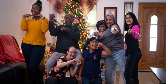 The Agnew family from left: Soriah (16), James, Serinity (15), Deandra (9),  Rihanna (11), Lorraine and Jacky (13) in front of their Christmas tree on Dec. 22, 2019.