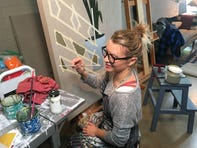 "Carrie Marill, at her Phoenix studio, works on a new painting for her show ""Protected Vulnerability,"" opening Jan. 7, 2020, at the Lisa Sette Gallery."
