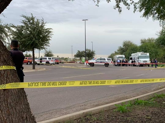 Police shot a man who shot two people in a parking lot outside Desert Sky Mall in Phoenix on Dec. 23, 2019.