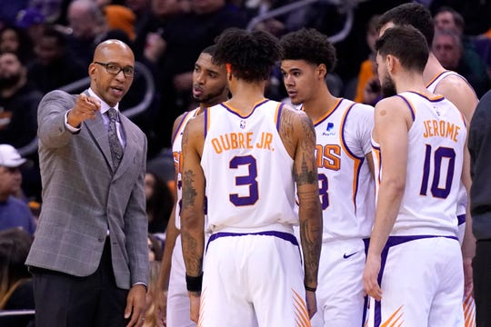 Phoenix Suns head coach Monty Williams talks to his team during a timeout in the first half during an NBA basketball game against the Denver Nuggets, Monday, Dec. 23, 2019, in Phoenix. (AP Photo/Rick Scuteri)