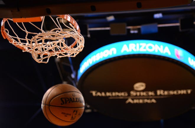 Dec 23, 2019; Phoenix, Arizona, USA; A ball goes through the hoop during warmups prior to the game between the Phoenix Suns and the Denver Nuggets at Talking Stick Resort Arena. Mandatory Credit: Joe Camporeale-USA TODAY Sports