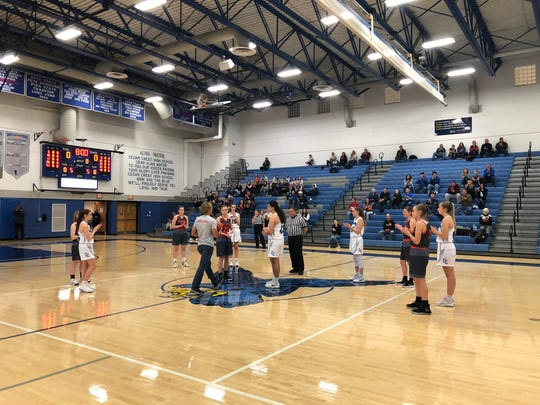 Mike Bare presents the game ball prior to Saturday's Team Up 4 Good game between the Palmyra and Cedar Crest girls basketball teams in honor of his late wife, Linda Bare.