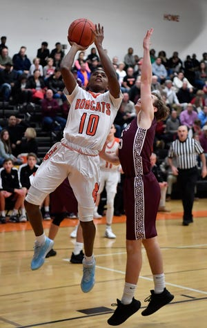 Kaden Hamilton of Northeastern goes up past Gettysburg defender Mike Hankey for the Bobcats first basket of the game, Monday, December 23, 2019. John A. Pavoncello photo