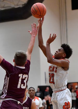 Northeastern's Karron Mallory, seen here at right in a file photo, scored 15 points on Tuesday in the Bobcats' win over Central York.