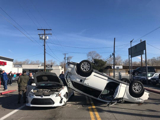 A car ended up on its roof after being struck by another vehicle that had run a red light on Tuesday, Dec. 24 at Kietzke Lane and Gentry way in Reno. No one was seriously injured.