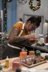 Melissa Yanc works on a challenge in The Holiday Baking Championship.