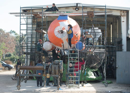 Students work on the submarine portion of the Aquatic Aspirations float in Pomona.